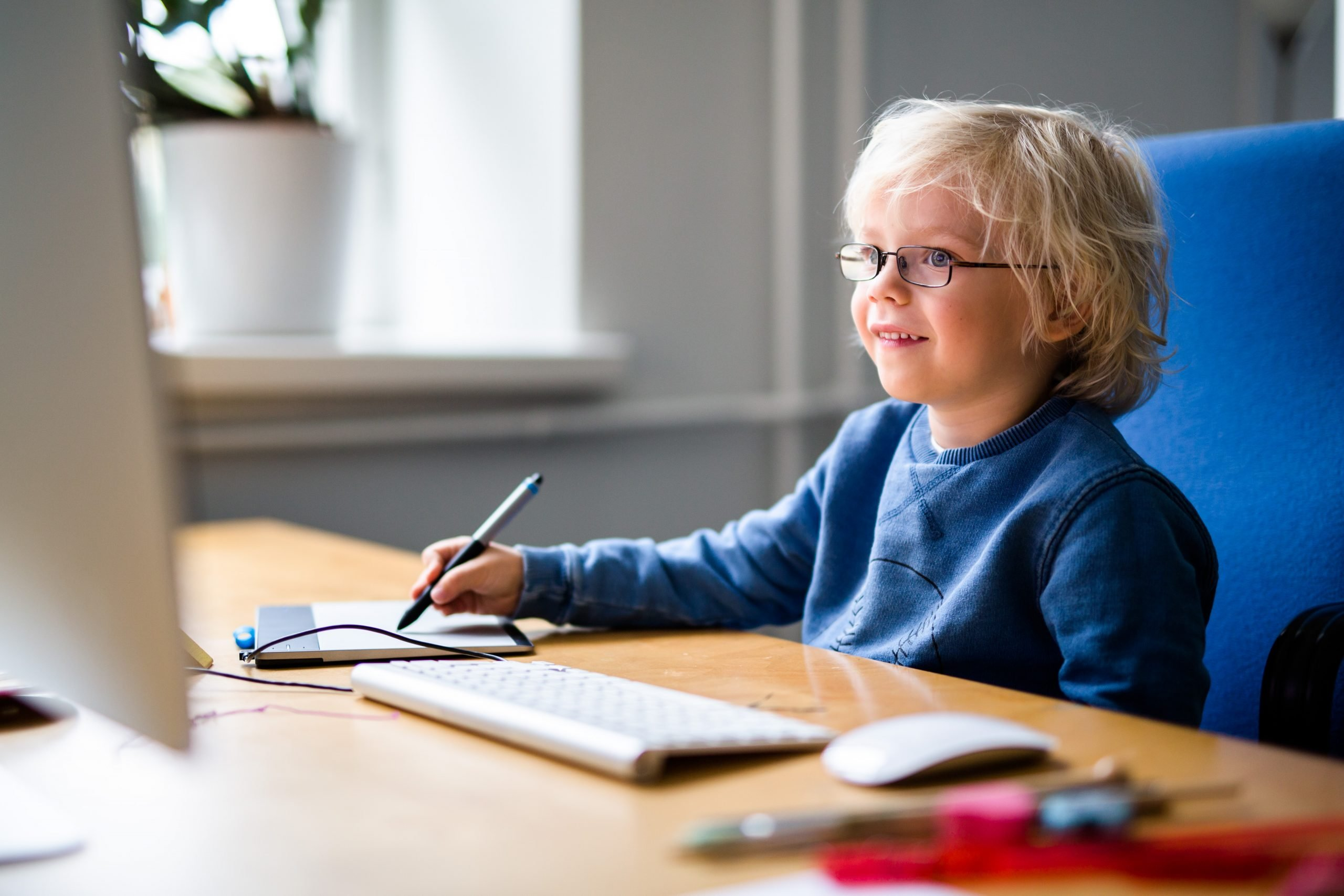 Boy learning at computer